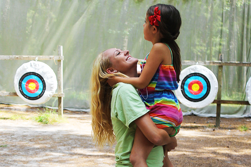 girl at archery range